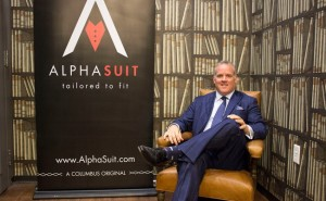 Sean McKee with Alphasuit Brand sign