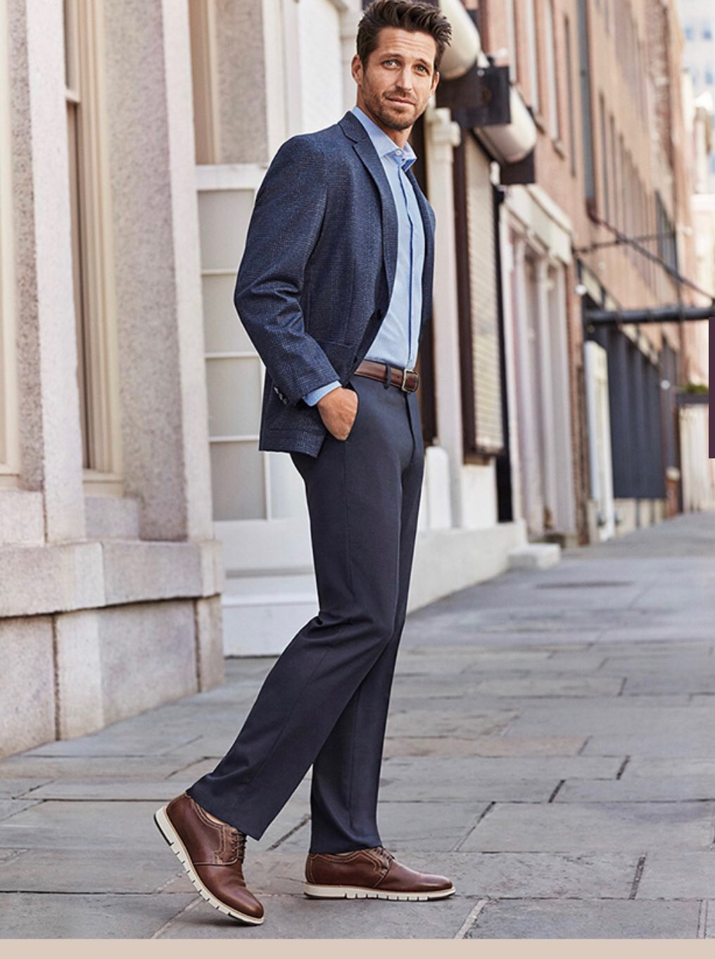 Man wearing navy suit with gray pants & loafers
