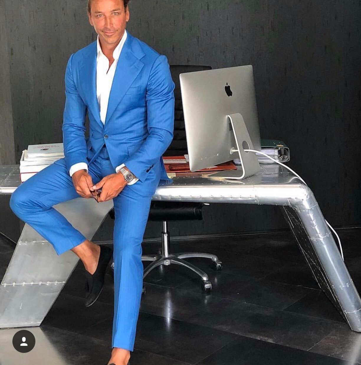 Man wearing a royal blue full suit for a stylish boardroom look